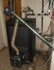 Rotary pellet burner BurnPell EVO Mini (26 kW) installed in solid fuel boiler SIRIJUS